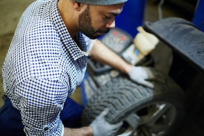 Mechanic with tire