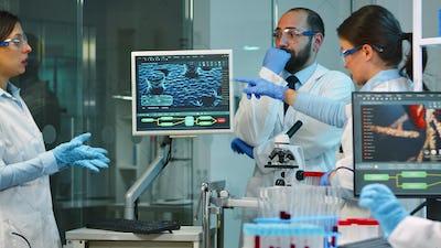 Team of doctors conducting vaccine development using high tech