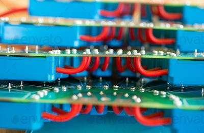 Close-up of a large green microcircuit with blue components