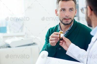 Taking pill-bottle