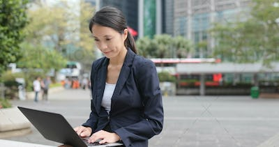 Asian business woman use of notebook computer in Hong Kong