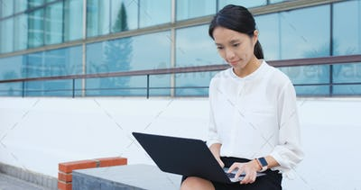 Young business woman use of laptop computer
