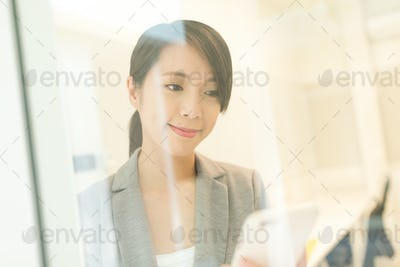 Business woman looking at cellphone