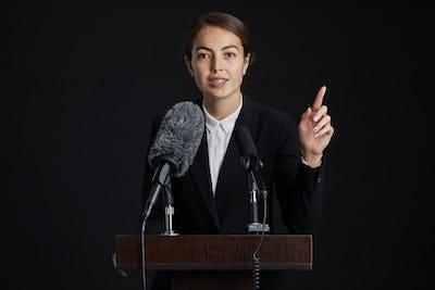 Confident Female Speaker at Podium