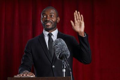 African-American Man Speaking at Podium