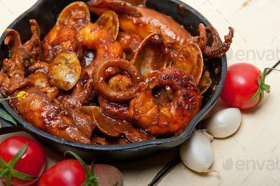 fresh seafoos stew on an iron skillet