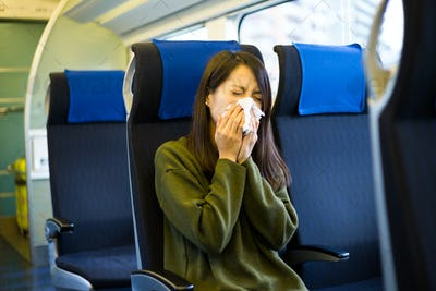 Woman get cold in train compartment
