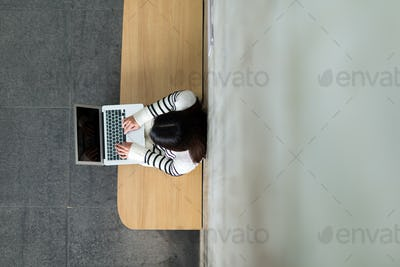 Top view of woman working on laptop computer