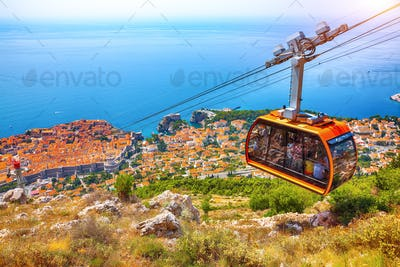 panoramic view of the old town of Dubrovnik with famous Cable Car on Srd mountain on a sunny day.
