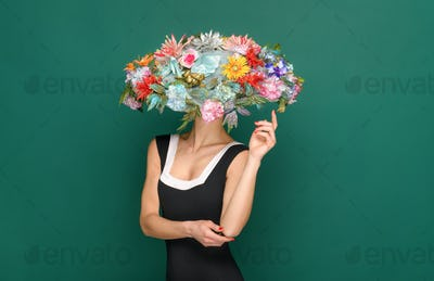 Elegant woman wearing wide brimmed floral hat