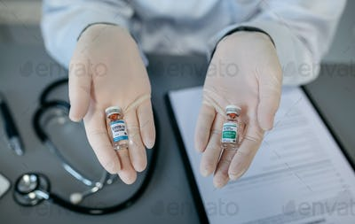 Doctor hands showing two coronavirus vaccine options
