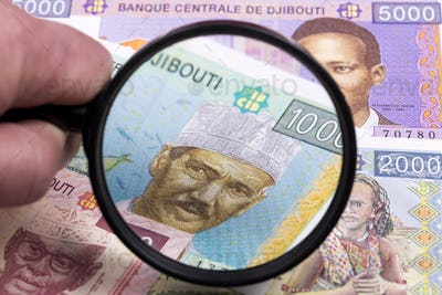 Djiboutian money in a magnifying glass