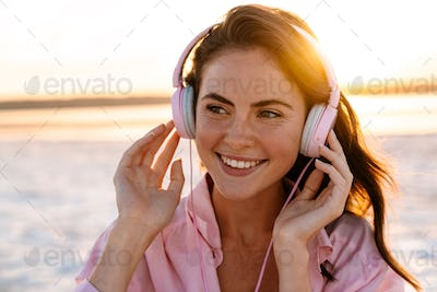 Relaxed woman wearing headphones listening to music