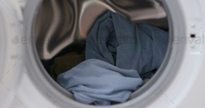 Load clothes to washer machine