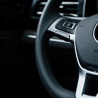 Smooth material. Close up view of interior of brand new modern luxury automobile