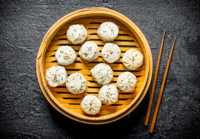 Traditional food. Dumplings manta in a bamboo steamer.