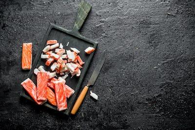 Sliced crab sticks on a cutting Board.