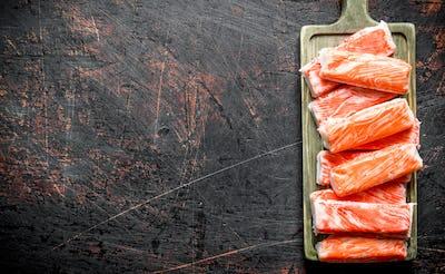 Crab sticks on the cutting Board.