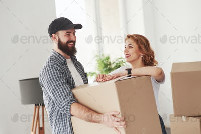 Positive emotions. Happy couple together in their new house. Conception of moving