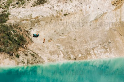 Vaukavysk chalk pits or Belarusian Maldives are beautiful saturated blue lakes.Two tourists pull a