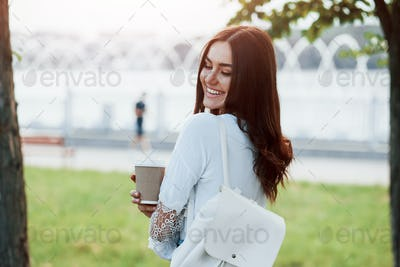 Cozy atmosphere. Young woman have good time in the park at her weekend