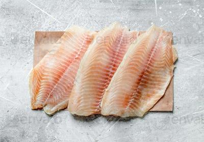 Fish fillet on paper.