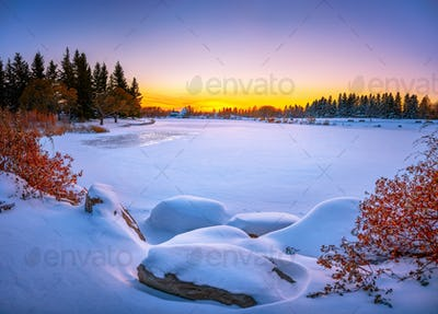 Vibrant winter landscape. Frozen lake
