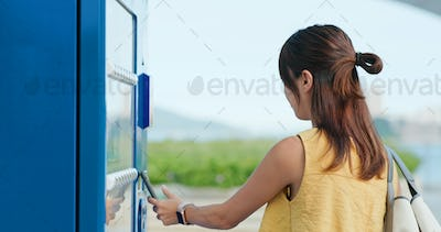 Woman use mobile phone to buy a drink at outdoor