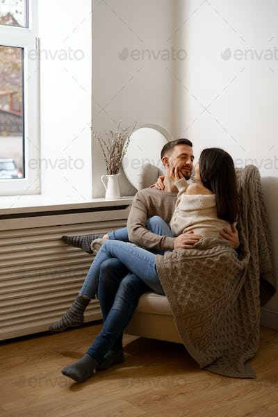 Romantic happy young couple enjoying holiday at home smiling