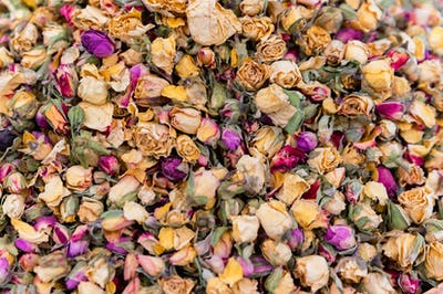 Close up dried colorful roses heap at turkish market