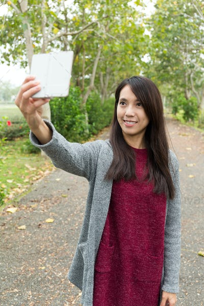 Asian Woman taking photo for herself