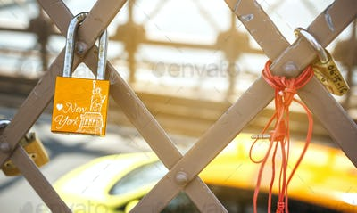Love lock with Statue of Liberty and yellow cab on background