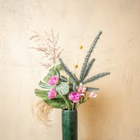 Composition of fresh flowers on beige background