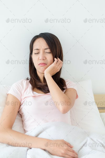 Woman suffer from toothache