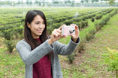 Asian Woman use of the camera