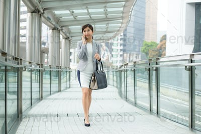 Business woman talking on phone outdoor