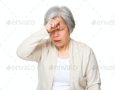 Retired woman feeling headache