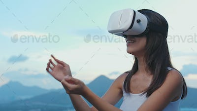 Woman watching on VR device on roof top