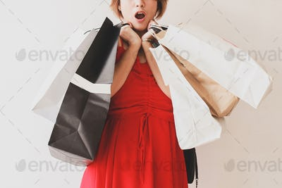 Shocked Expression Woman with Shopping Bags