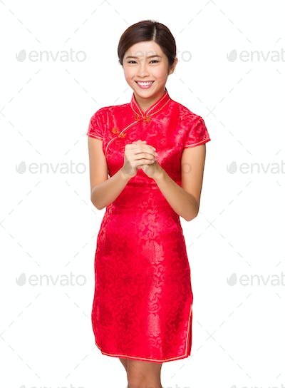 Asian woman with congratulation sign
