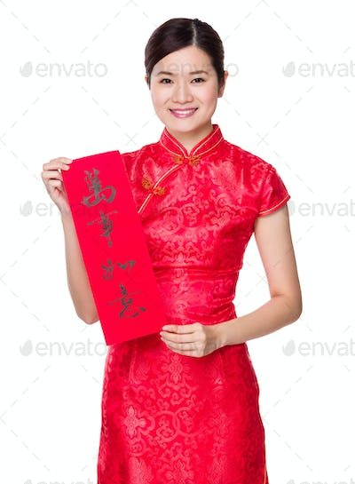 Chinese woman hold with Fai Chun, phrase meaning is everything goes smooth