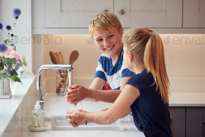Two Children Washing Hands With Soap At Home To Prevent Spread Of Infection In Health Pandemic