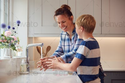 Mother And Son Washing Hands With Soap At Home To Stop Spread Of Infection In Health Pandemic