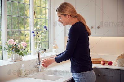Woman Washing Hands With Soap At Home To Stop Spread Of Infection In Health Pandemic