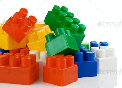 colorful plastic toys bricks isolated on white