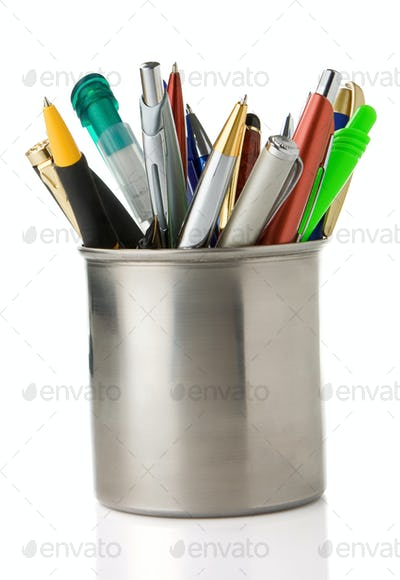 holder basket full of pencils and pens isolated on white