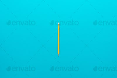 Photo Of Yellow Pencil Over Turquoise Blue Background With Copy Space