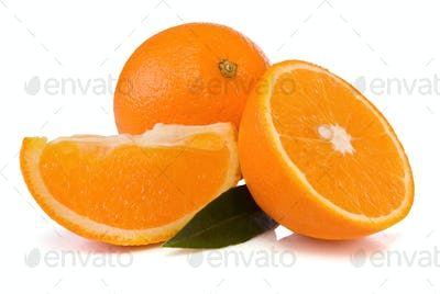 oranges and green leaves isolated on white