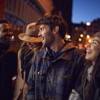 Group Of Friends In City Outdoors On Night Out Together
