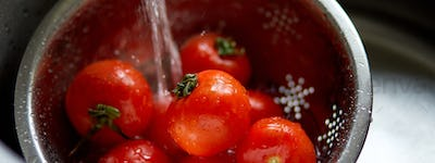 Banner of Fresh red tomatoes splashing in water before cooking at home